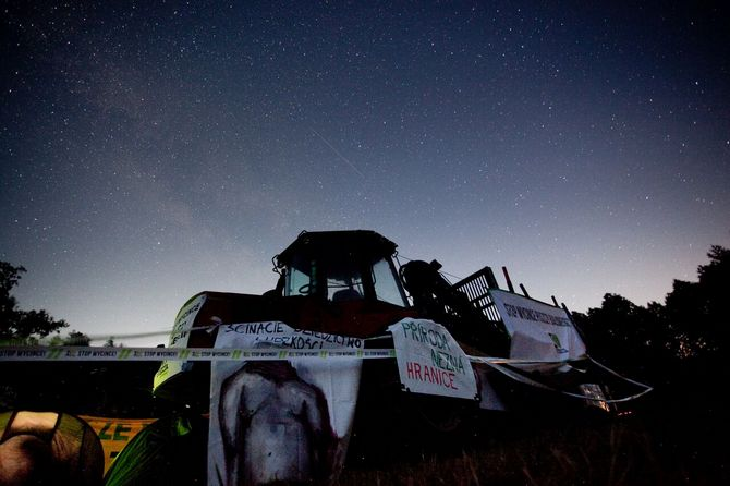 Starry sky above the harvester occupied by protesters
