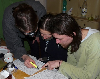 Volunteers recording their route in a map