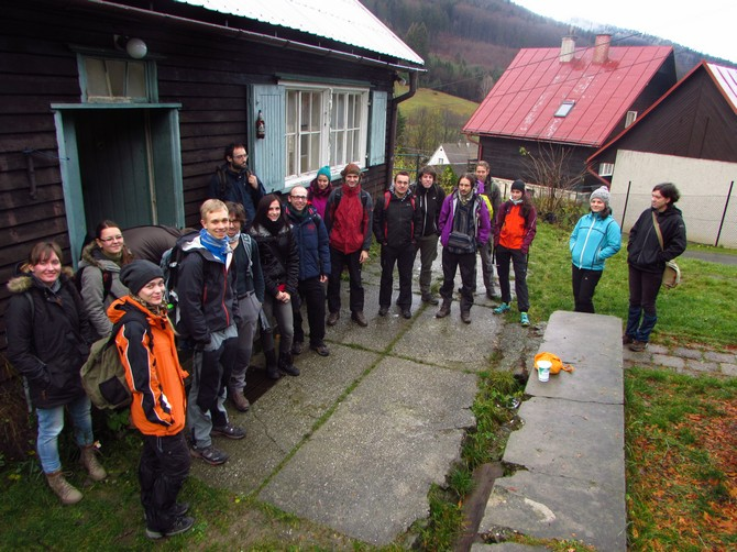 Volunteers outside the mountain chalet in the Beskydy Mountains